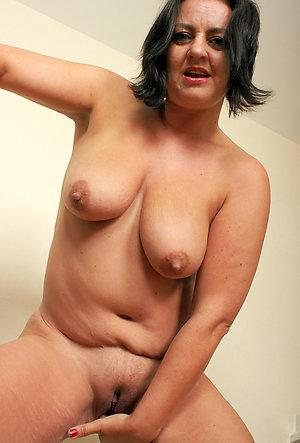 Busty mature masturbation porn pics
