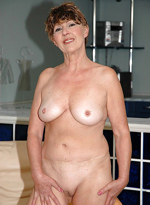 Busty mature shaved pussy sex photos