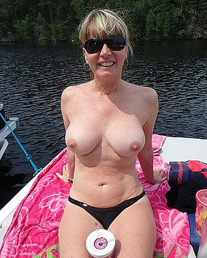 Busty mom shows tits stripped