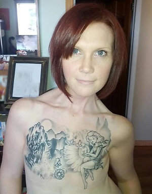 Tattooed Mature