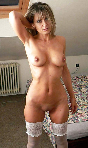 Naughty mature solo orgasm pics
