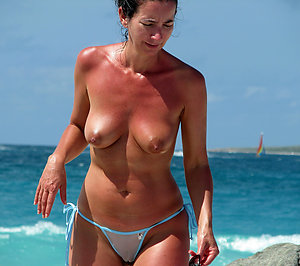 Naughty mature on beach