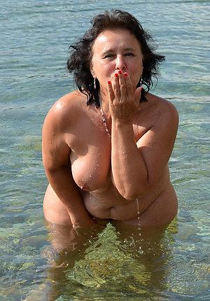 Busty mature topless beach