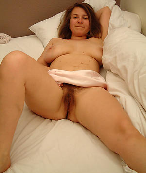 Naughty unshaved mature pussy
