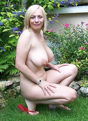 Slutty mature blonde masturbating