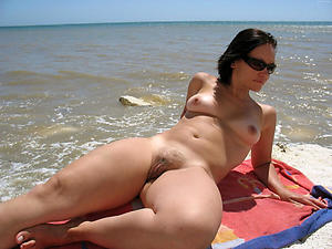 Wet pussy mature at the beach