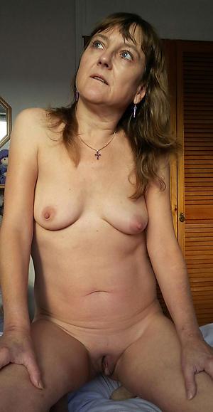Nude mature woman desolate photo