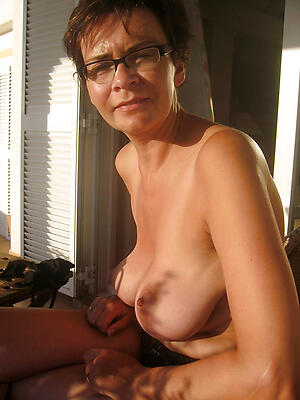 Beautiful naked mature fro glasses photo