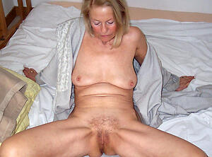Hot mature small tits and  pussy pics