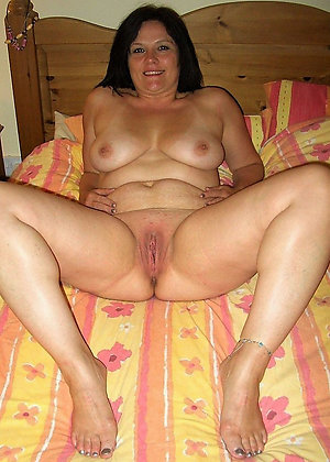 Homemade mature spreading legs photo